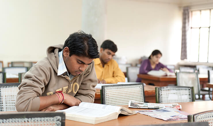 Converting Secondary Grades from India Lead Image: A photo of Indian students studying