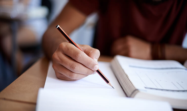 A Guide to the GCE A Level Lead Image: Photo of a student taking an examination