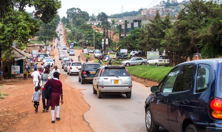 Education in Uganda Lead Image: Photo showing a street crowded with pedestrians and motor vehicles in Uganda