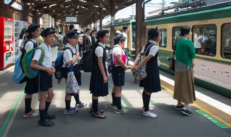 Education in Japan Lead Image: Photo of Japanese students at a train station